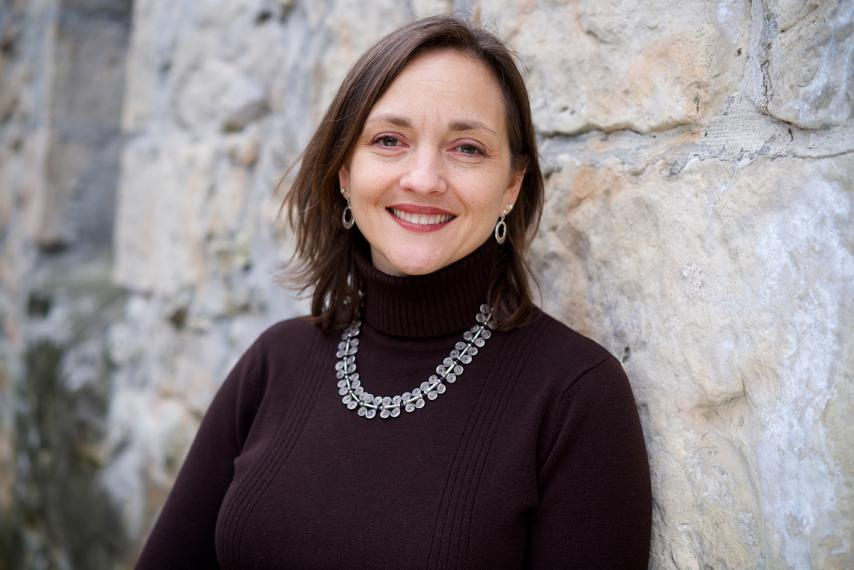 Justine Richardson in front of a stone wall