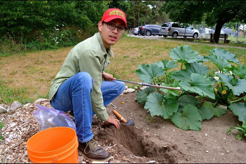 Fernando Montaño Lopez taking soil samples from a community garden plot.