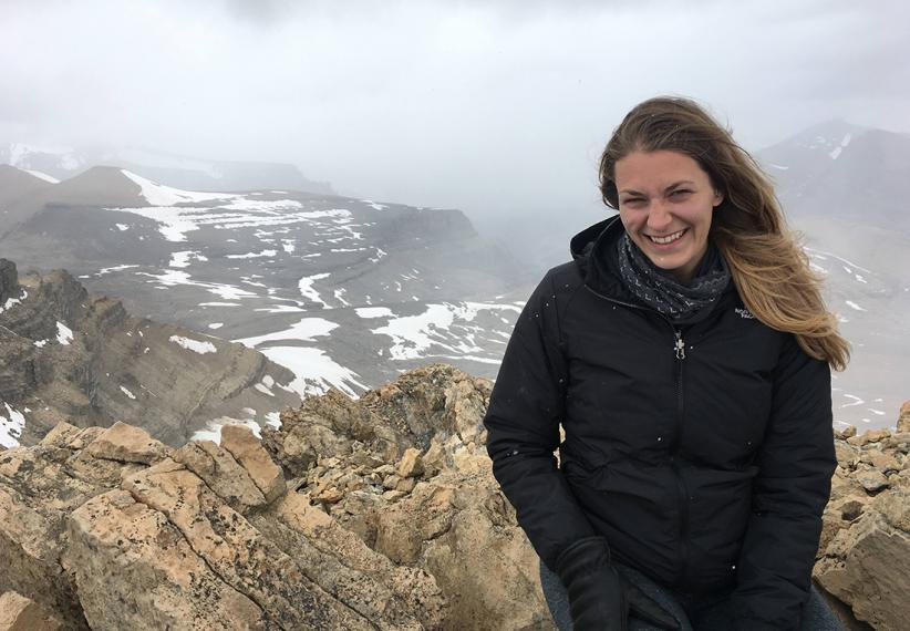 Melissa smiling with snow-covered mountains in the background