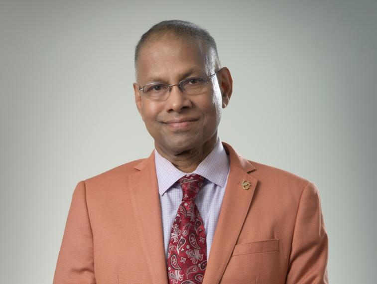Amar Mohanty in salmon coloured suit