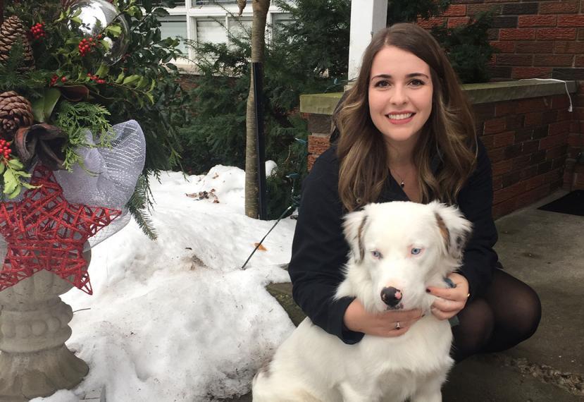 Emma huging white dog