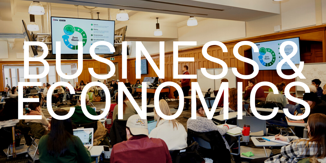 """students in a classroom with the words """"business & economics"""" overlayed"""