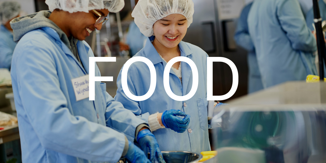 """Two students in a food science lab, with the text """"Food"""" overlaid."""