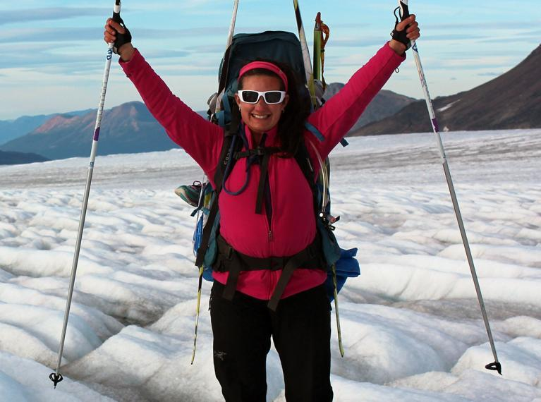 Laurissa wearing sunglasses and outdoor gear while treking on a glacier