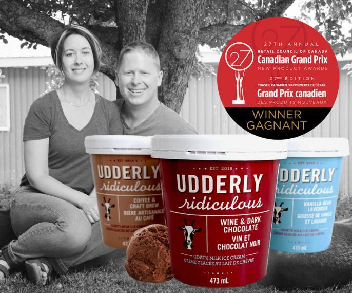 Greg and Cheryl Haskett with Udderly Ridiculous ice cream containers and Canadian Grand Prix award badge