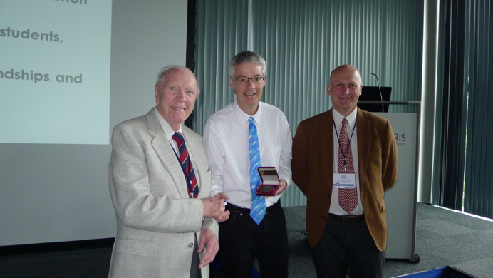 Doug stands with Prof. Gly Phillips and Dr. Graham Sworn as he recieves his award