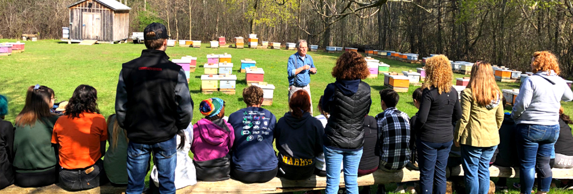 Students getting a tour of the Honey Bee Research Centre.