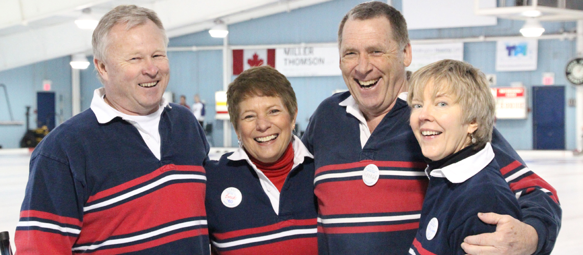 Two males and two females together in matching shirts at curling bonspiel