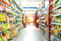 Blurred image of a grocery store aisle.