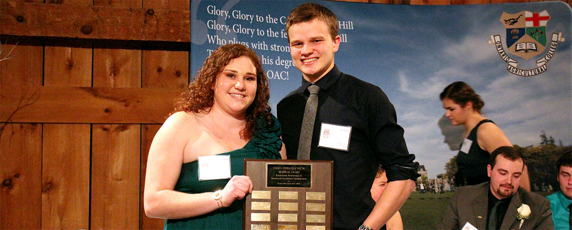 Students Chris and Julia pose with trophy