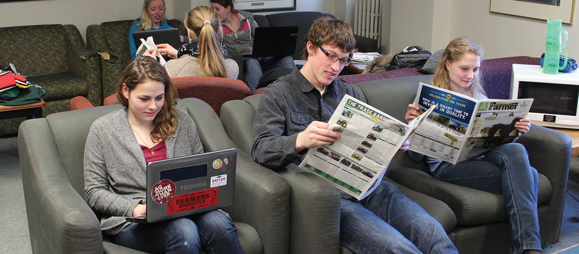 Students in lounge space reading