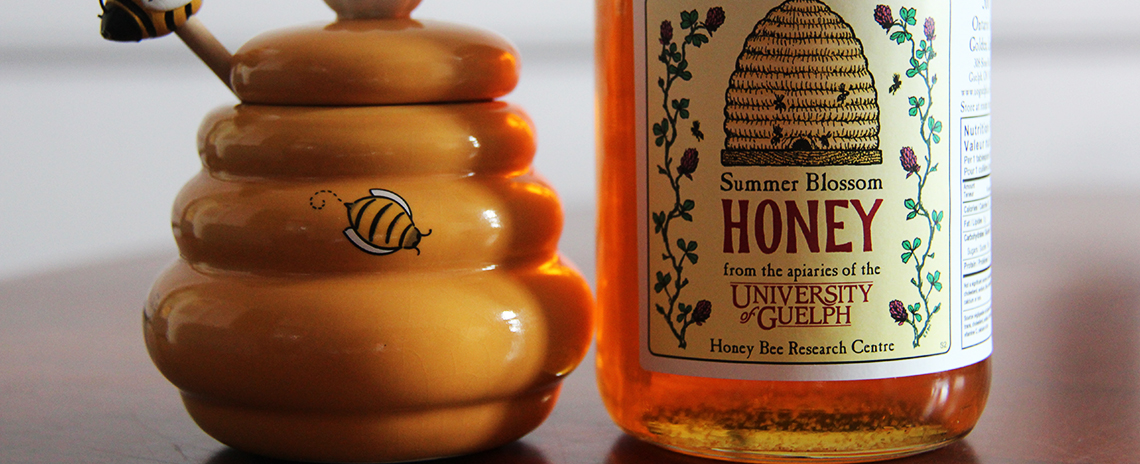 A honey pot and honey from U of G.