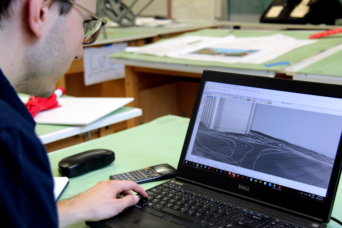 Michal works on a 3D model on his computer.