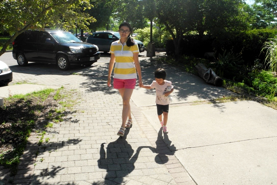 Qin walks with daughter.
