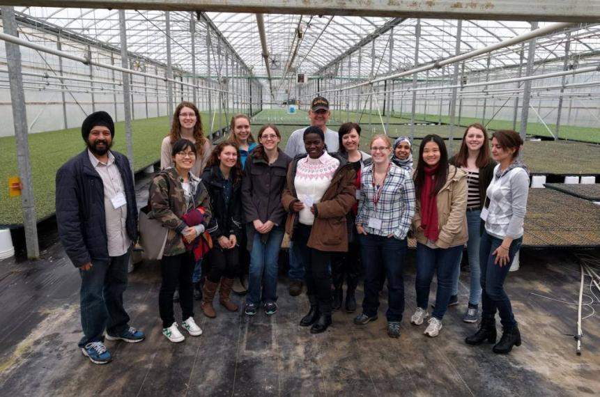 Group of students with Wayne Sonneveld of Lakeview Greenhouses inside large greenhouse