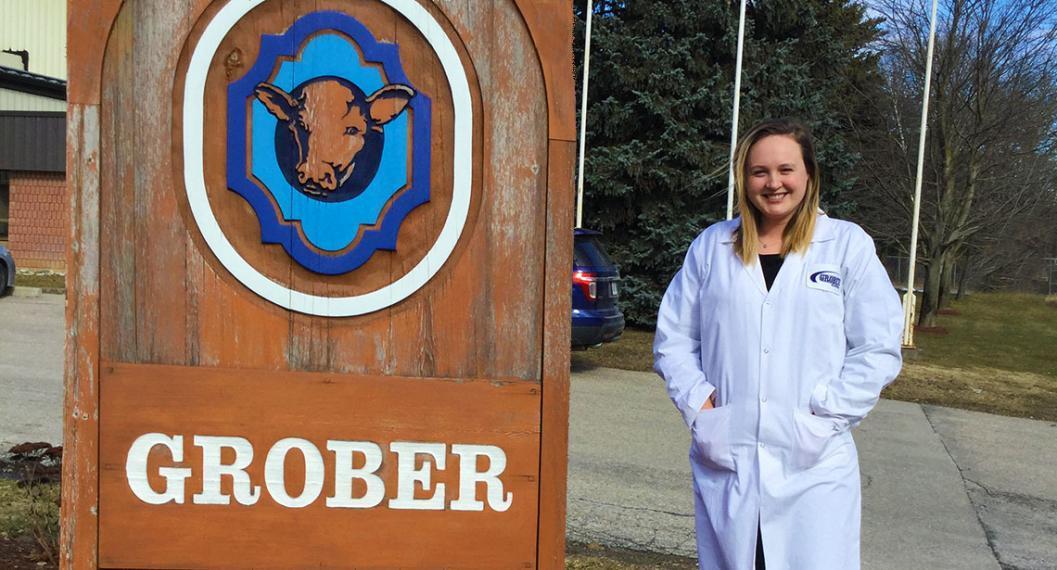 Nikki stands next to a large Grober sign.