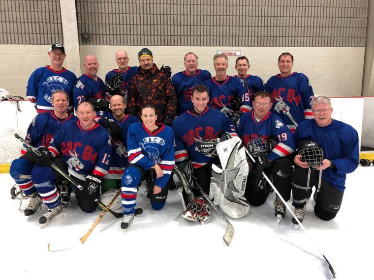 Team photos on the ice in OAC '84 jerseys