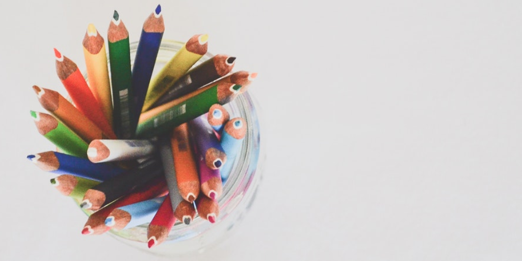A cup full of pencil crayons.
