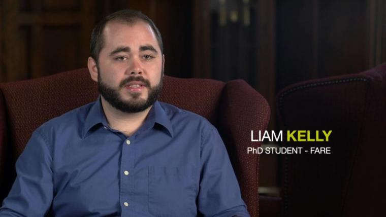Liam Kelly sitting in arm chair with text overlay saying Liam Kelly PhD FARE student