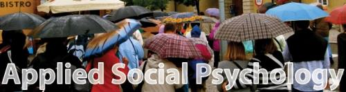 Applied Social Psychology Image of crowd with umbrellas