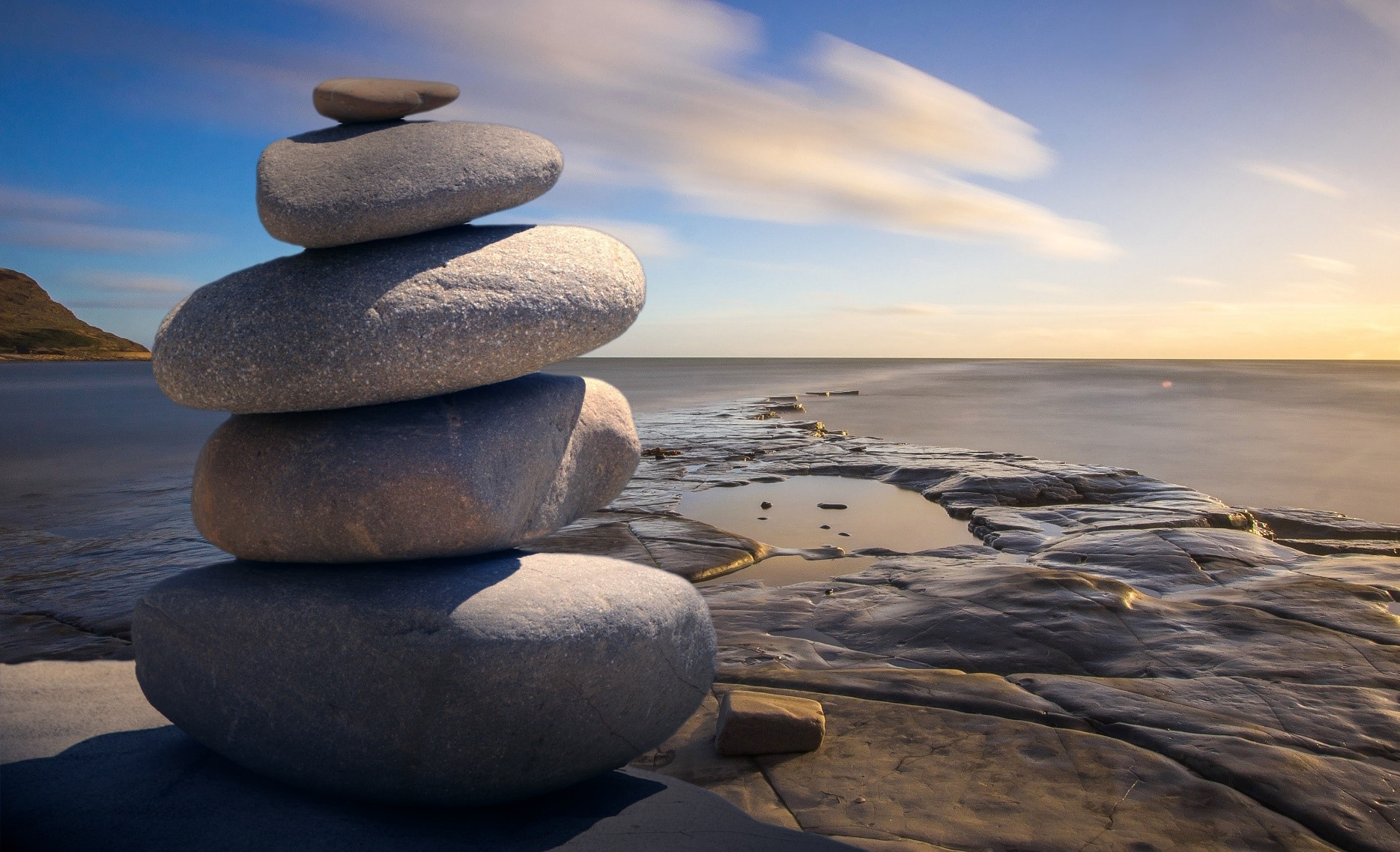 soothing image of rock pile and water