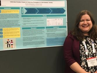 Brooke Charbonneau and her research poster