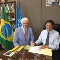 Left to right: Interim Vice-President of Research John Livernois and Alan Botanic, PhD, Brazil Representative of the Food and Agriculture Association, signing a Memorandum of Understanding (MOU).
