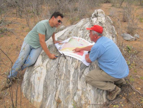 In the field - Dr. Clistenes Nascimento, Federal Rural Unversity of Pernambuco and Dr. Peter van Straaten, University of Guelph, discussing formation of special metamorphic rocks in Pernambuco State.