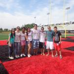 Science without Borders students standing on the field of Alumni Stadium.