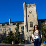 Science without Borders student in front of the Johnston Hall clock tower.