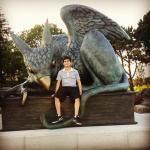 Science without Borders student sitting on the Gryphon statue.