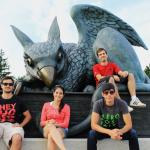 Science without Borders students sitting in front of the Gryphon statue.