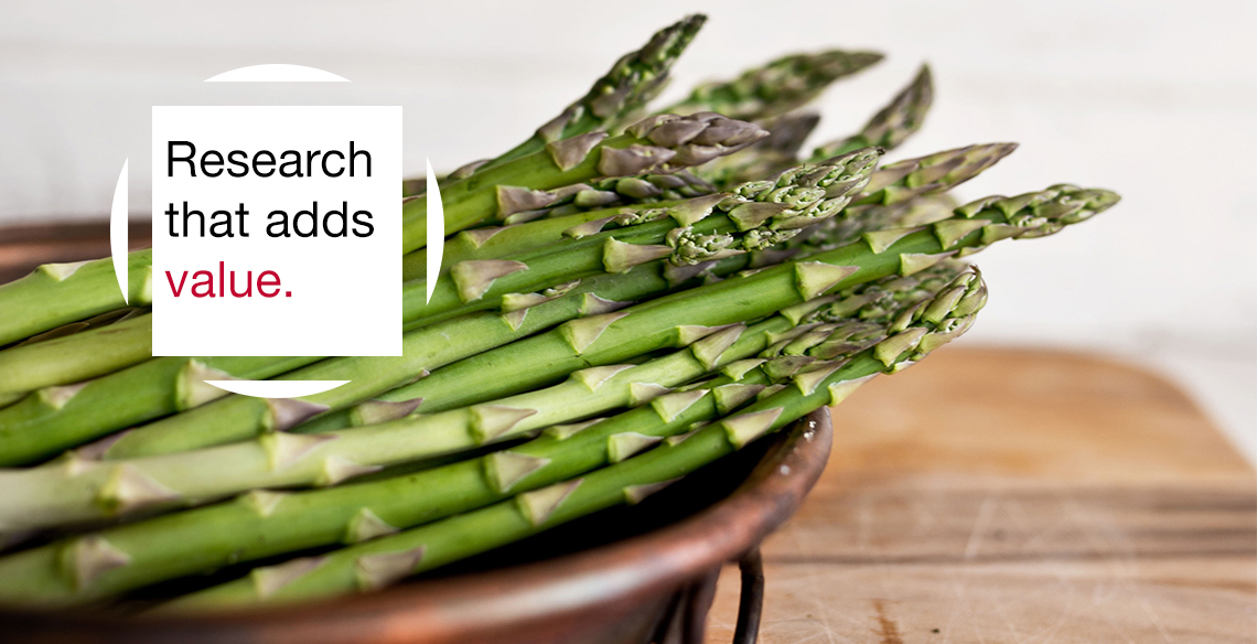 "Asparagus with text overlay reading ""Research that adds value."""