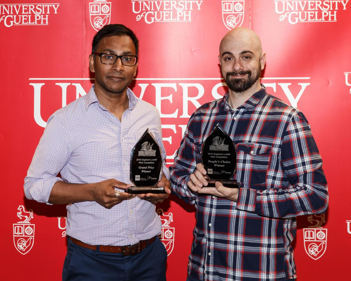 Sujeevan Ratnasingham, Grand Prize Winner, and Kevin Piunno, People's Choice Award Winner, stand with their trophies