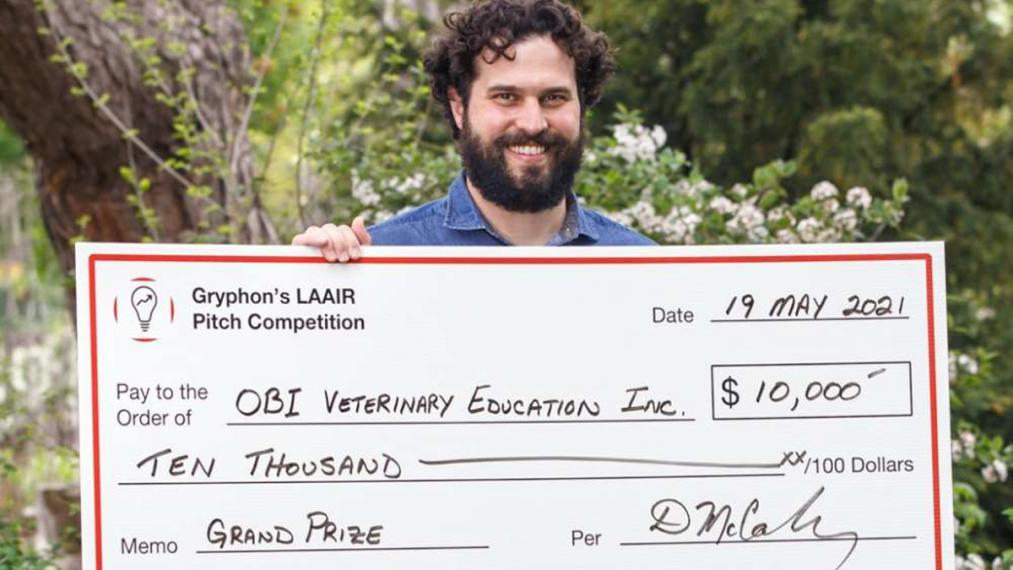 Obi Veterinary Education co-founder Dr. Ryan Appleby with Grand Prize Award cheque