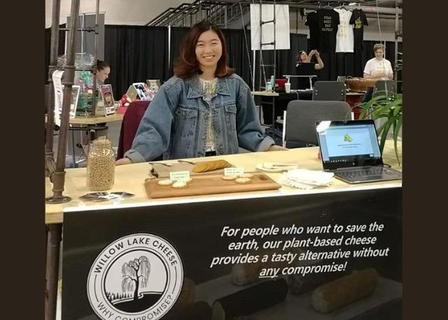 Jane Ong at the Willow Lake Cheese trade show booth.