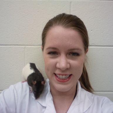 Image of a women with a rat on her right shoulder
