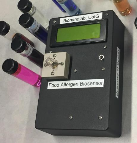 Photo of the sensor with vials of potential allergens beside it
