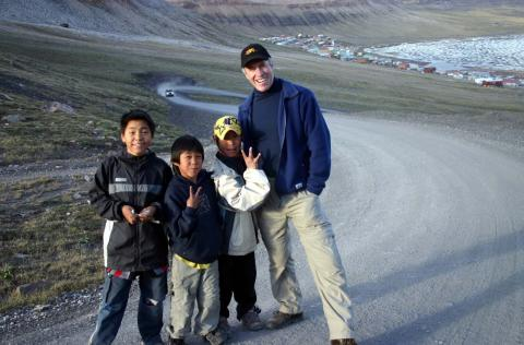 Photo of Barry Smith with three children in a Northern setting