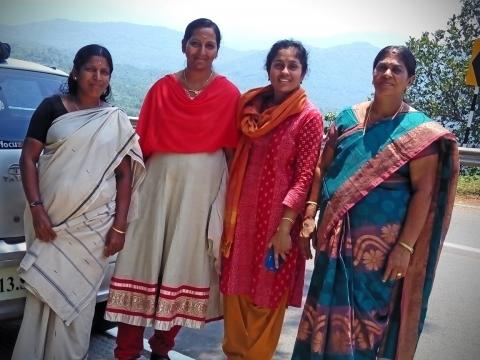 Photo of four women in colourful saris