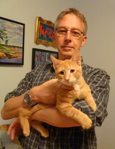 Prof. Olaf Berke holds an orange cat