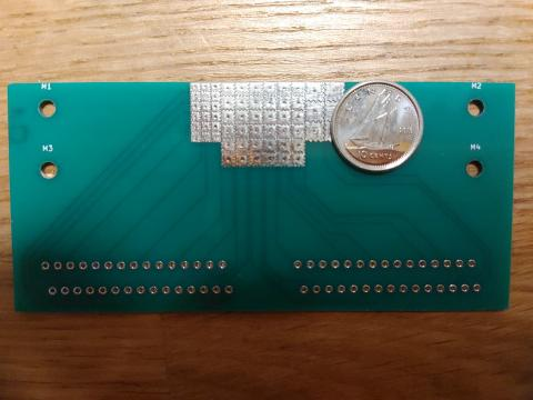 The microfluidic device, with a dime for scale.
