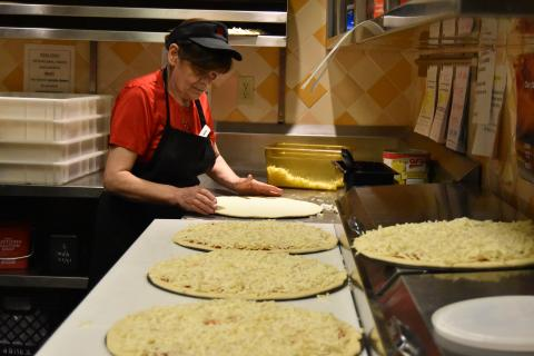 Photo of a woman making pizza