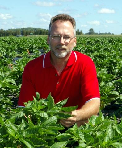 Photo of John Zandstra in a field.