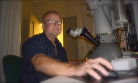 Robert Harris works on a microscope
