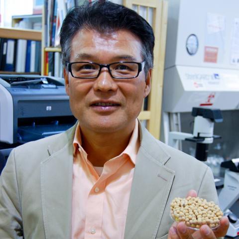 Prof. Yoshi Mine holds soy beans
