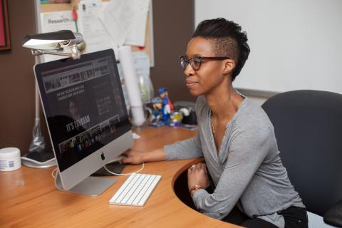 Photo of Tamara Small looking at her computer