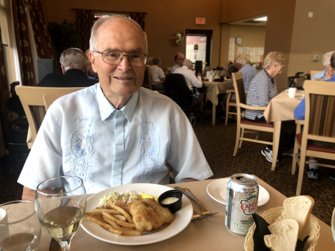 older male eating at a restaurant