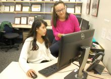 A photo of SPARK writer Marika Li (left) conferring with senior SPARK writer Alaina Osborne (right) about the 150 innovation project