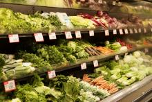 Fresh vegetables on shelves at a grocery store